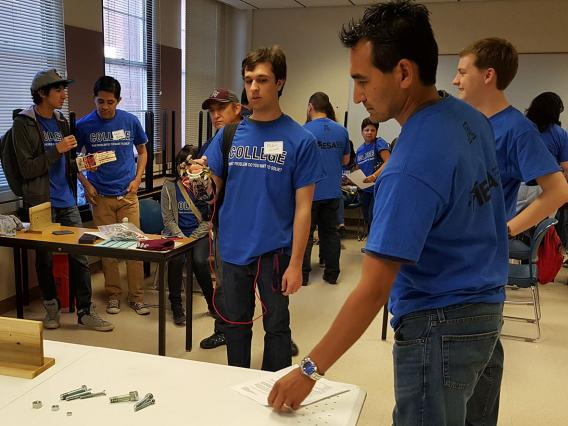 MESA Alum assisting with Prosthetic Arm Competition